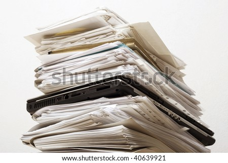 Pile of documents and the laptop