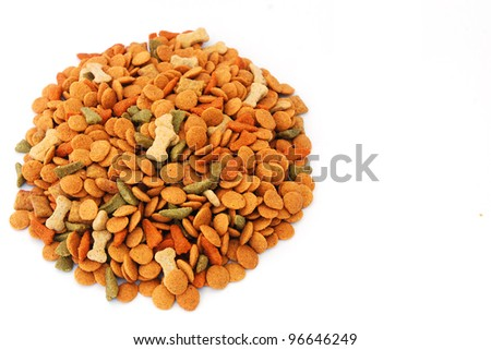 Pile of dog food bits on white background