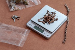 Pile of dried magic mushrooms on a scale. Micro-dosing on psychedelic natural drugs.
