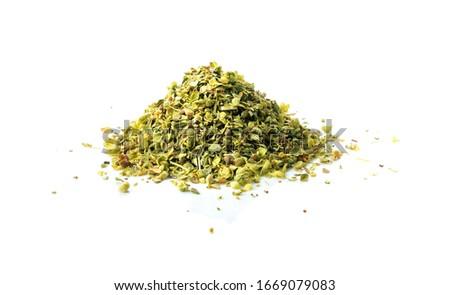 Pile of dried oregano leaves isolated on white background Stock photo ©