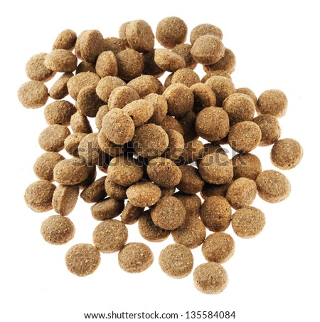 Pile of dry dog food isolated on white background, seen from directly above.