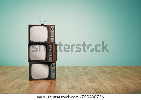 Pile of empty vintage TVs in interior with blue wall and wooden floor. Creativity concept. 3D Rendering