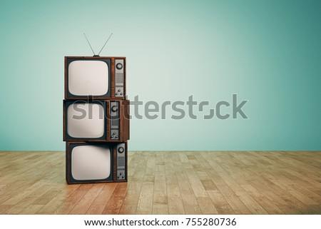 pile of empty vintage tvs in...