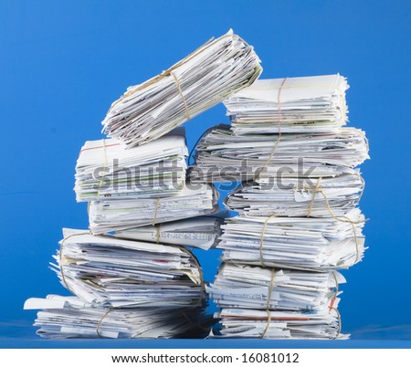 Pile of envelopes, letters, bills, forms. Isolated on blue