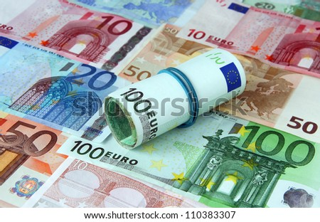Pile of euro currency bank notes background