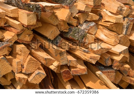 Pile of firewood. Preparation of firewood for the winter and use for cooking, firewood background, Stacks of firewood in the forest. #672359386