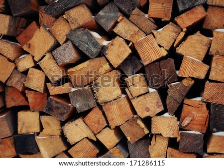 pile of firewood. snowy firewoods in winter forest  #171286115