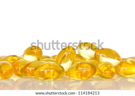 Pile of fish oil capsules over a white background