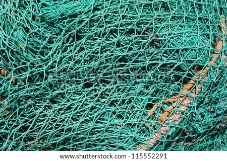 Pile of fishing nets on a quay