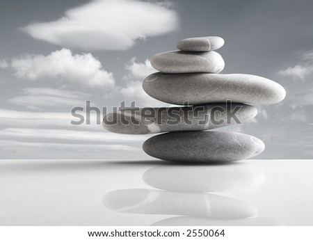 Pile of five stones over sky