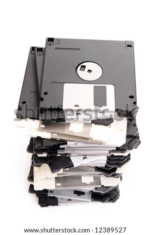 Pile of floppy disks over white