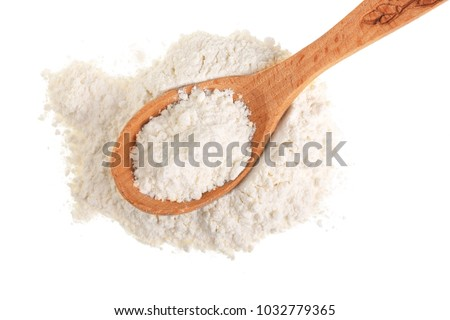 Pile of flour in wooden spoon isolated on white background. Top view. Flat lay Foto d'archivio ©
