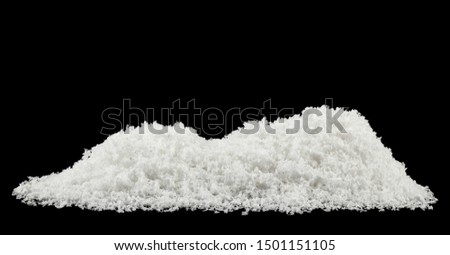 pile of fluffy white snow isolated on a black background.