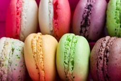 pile of french multicolored  macaroons close up