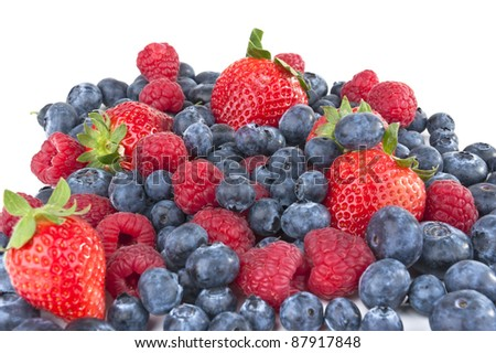 Pile of fresh berries - strawberries, blueberries and raspberries