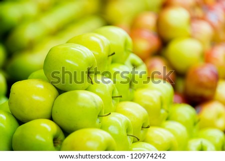Pile of fresh green apples at the supermarket