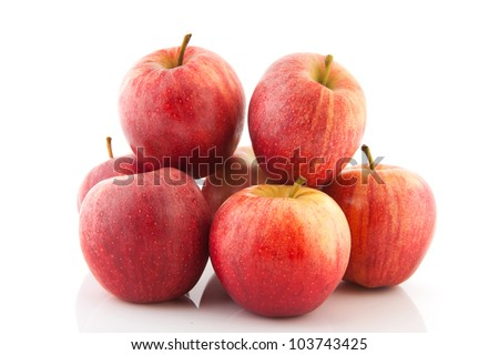 Pile of fresh red apples isolated over white background