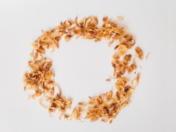 Pile of fried Indonesian Deep Onion fries (Bawang Goreng) or shallots with circle shape isolated on white background.
