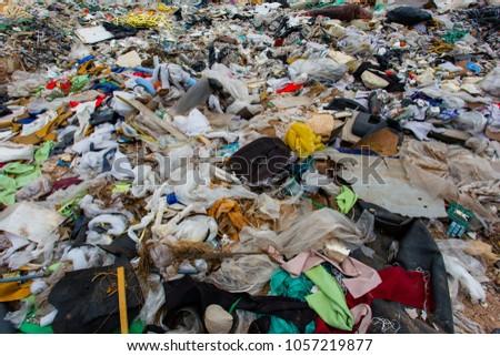 pile of garbage , garbage dump ,Waste from household in waste landfill , global warming #1057219877