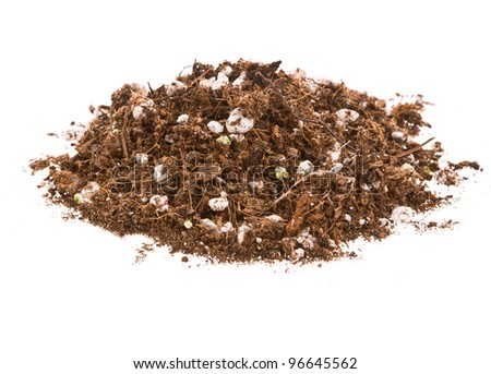 Pile of garden soil with fertilizer pellets on a white background