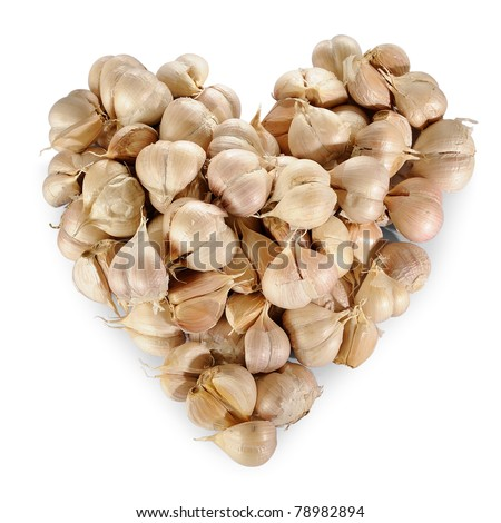 Pile of Garlic in heart shape isolated on a white background.
