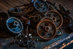 Pile of gears at an abandoned silk mill.