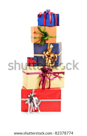 Pile of gift boxes of various colors isolated on white background