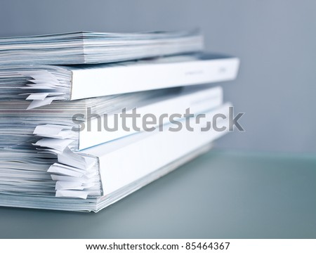 Pile of glossy magazines close up