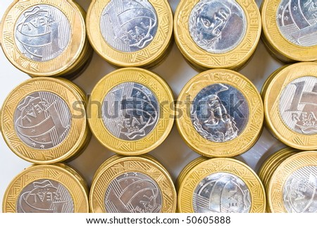 Pile of Golden and Silver coins on white background .