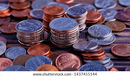 Pile of Golden coin, silver coin, copper coin, quarters, nickels, dimes, pennies, fifty cent piece and dollar coins. Various USA coins, American coins for business, money, financial coins and economy #1437455144