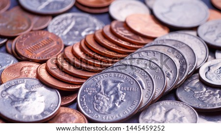 Pile of Golden coin, silver coin, copper coin, quarters, nickels, dimes, pennies, fifty cent piece and dollar coins. Various USA coins, American coins for business, money, financial coins and economy #1445459252