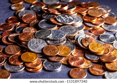 Pile of Golden coin, silver coin, copper coin, quarters, nickels, dimes, pennies, fifty cent piece and dollar coins. Various USA coins, American coins for business, money, financial coins and economy #1531897340