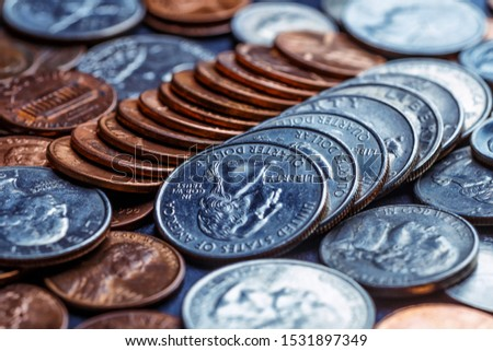 Pile of Golden coin, silver coin, copper coin, quarters, nickels, dimes, pennies, fifty cent piece and dollar coins. Various USA coins, American coins for business, money, financial coins and economy #1531897349