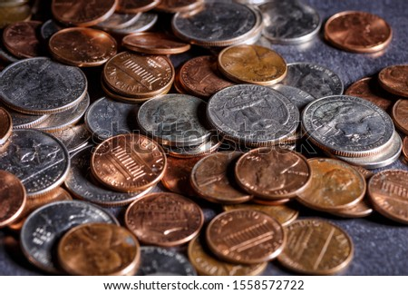 Pile of Golden coin, silver coin, copper coin, quarters, nickels, dimes, pennies, fifty cent piece and dollar coins. Various USA coins, American coins for business, money, financial coins and economy #1558572722