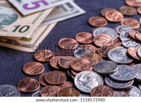 Pile of Golden coin, silver coin, copper coin, quarters, nickels, dimes, pennies, fifty cent piece and dollar coins. Various USA coins, American coins for business, money, financial coins and economy #1558572980