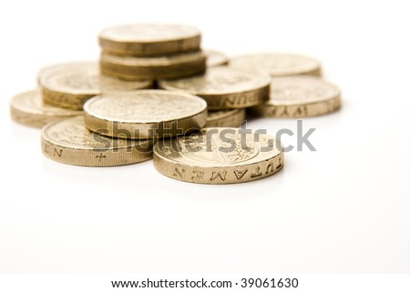 Pile of golden coins, shallow DOF, Focus on closest coin