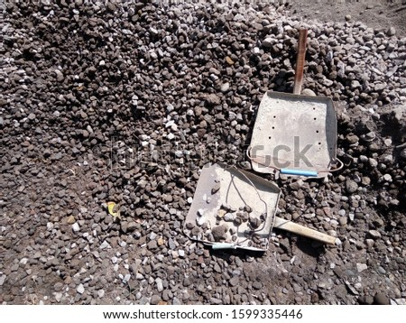 pile of gravel with a trowel.  building material as a basic material
