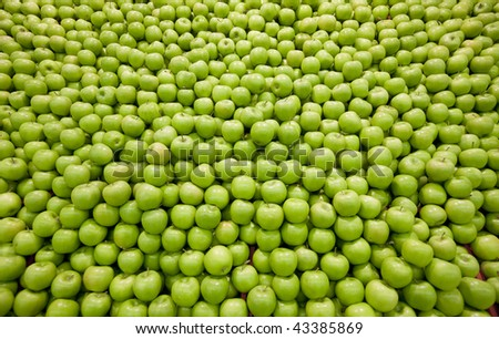 Pile of green apples forming a background