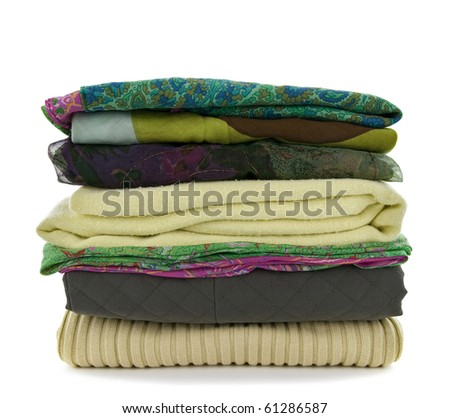 Pile of green casual clothes on white background.