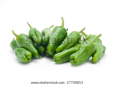 Pile of green peppers isolated on white background