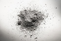 Pile of grey ash, dirt, sand, dust cloud, death remains background