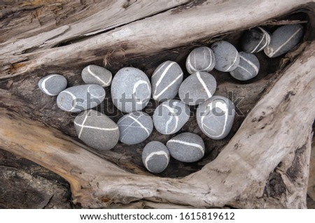 Pile of grey stones. Sea pebble. pebbles isolated on old wooden background