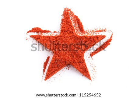 Pile of ground Paprika isolated in star shape on white background. Used to color rices, stews, and soups, meats.
