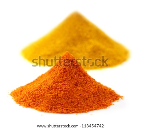 Pile of ground peppers and ground turmeric with selective focus