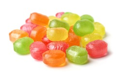 Pile of hard fruit candies isolated on white