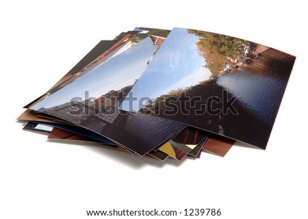 Pile of holiday photos, isolated on white background.