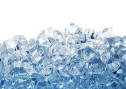Pile of ice cubes toned in blue isolated on white background