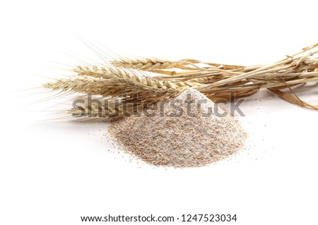 Pile of integral wheat flour and ears isolated on white Foto d'archivio ©