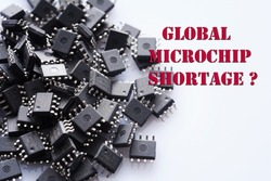 Pile of Integrated circuit chip on white background. Global microchip shortage. Concept for crisis in industry.