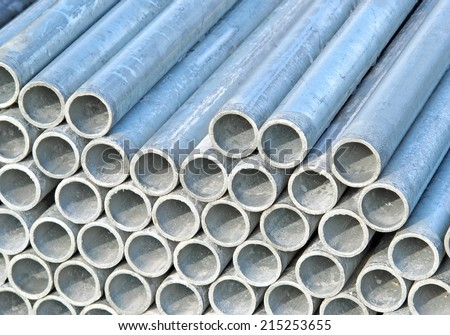 pile of iron pipes for the transport of electrical cables and optical fibres